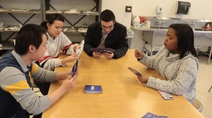 A group of friends playing Dogs of the Galaxies card game